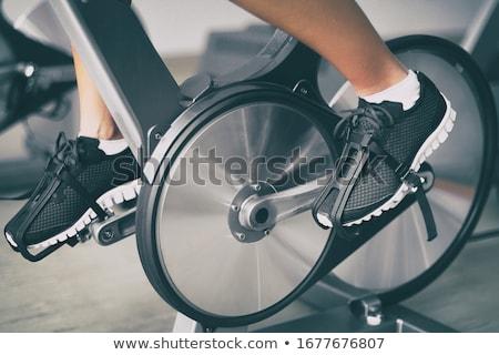 Stationary bike, gym machine Stock photo © Marfot