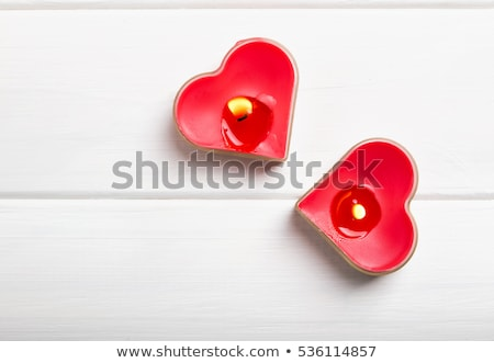 Two heart shaped burning candles Stock photo © AndreyKr