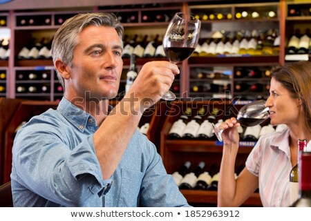 Man tilting glass of wine Stock photo © photography33