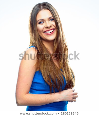 Beautiful young woman with long brown hair over blue. Pretty mod Stock photo © Victoria_Andreas