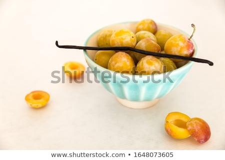 Yellow Mirabelles on white background Stock photo © lunamarina