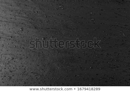 Macro shot of a slate plate with water drops Stock photo © Zerbor
