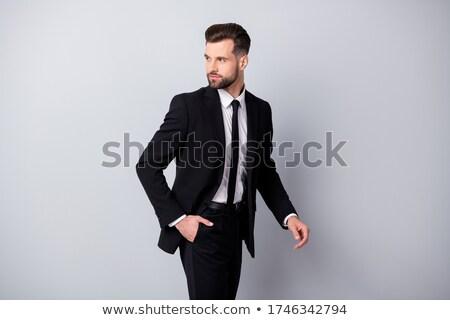 Genç takım elbise portre yakışıklı yalıtılmış Stok fotoğraf © ajn