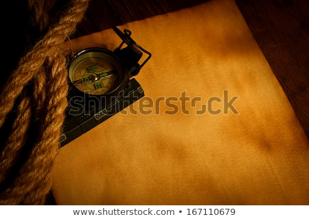 Compass and cordage on old paper Stock photo © kalozzolak