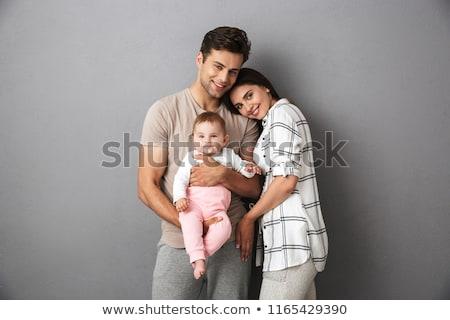 Fiatal családi portré stúdió fehér megérint gyönyörű Stock fotó © Anna_Om
