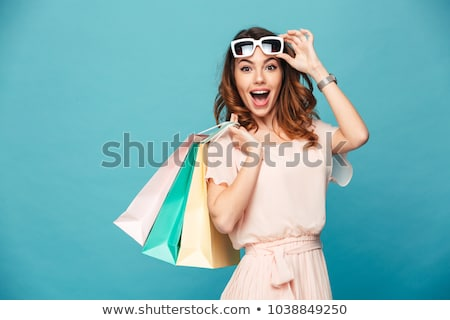 boldog · nő · tart · bevásárlótáskák · stúdió · mosoly - stock fotó © witthaya