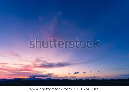 dark clouds and sunrise at evening sky stock photo © bsani