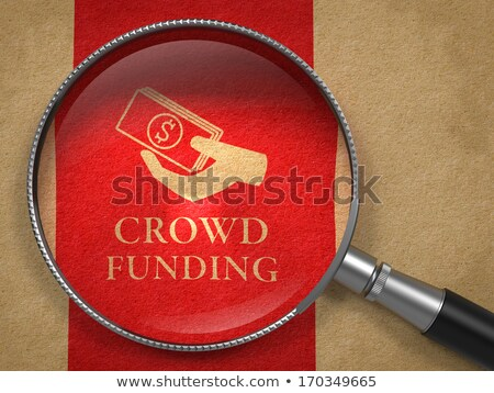 Crowd Funding Concept - Magnifying Glass. Stock photo © tashatuvango