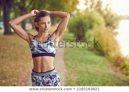 mulher · jovem · caminhada · deserto · belo · sorrir · paisagem - foto stock © konradbak