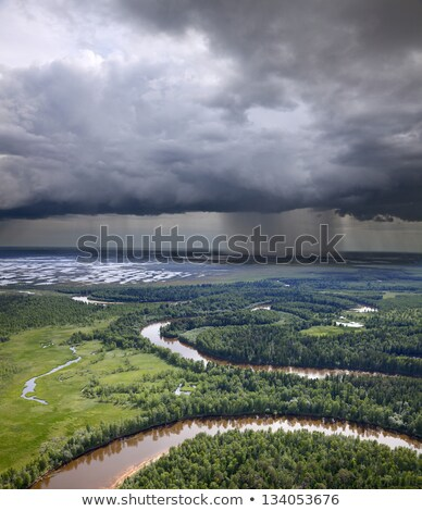 landscape with river and rain on horizon stock photo © mikko