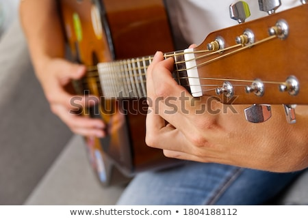 teenager with a guitar stock photo © oleksandro