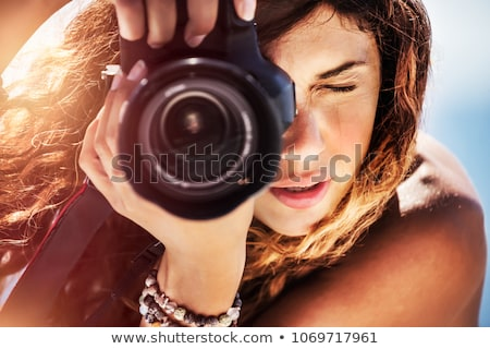 Young pro photographer with digital camera - DSLR  stock photo © lightpoet