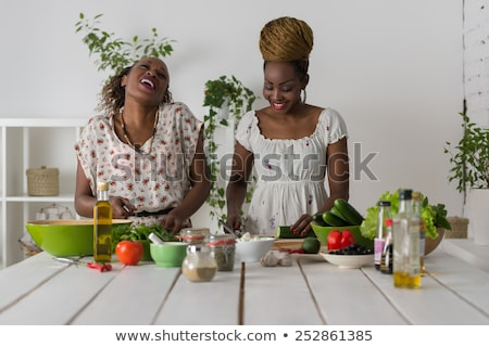 two african women cooking salad stock photo © hasloo