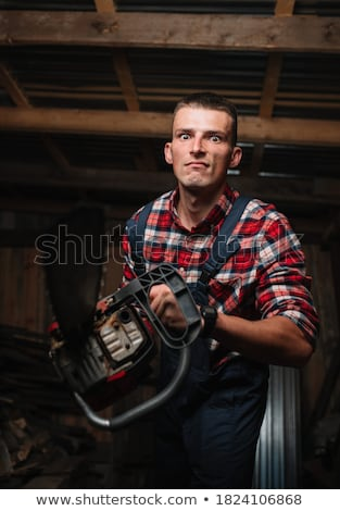 Crazy guy with chainsaw Stock photo © phakimata