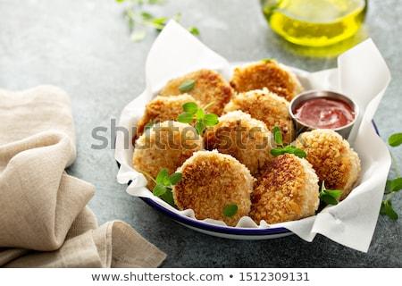 fresh fried fish cakes stock photo © klinker