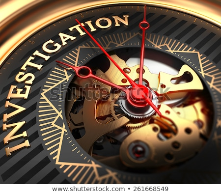 Stock photo: Investigation on Black-Golden Watch Face.