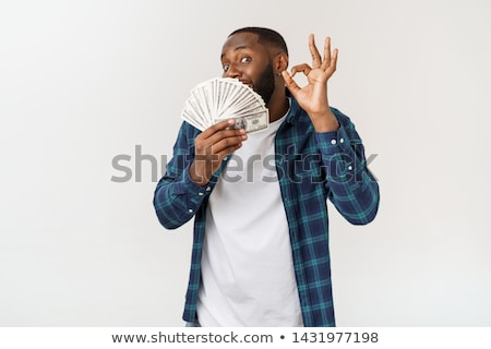 happy man holding money and showing ok stock photo © orensila