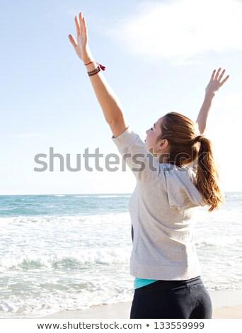Oldalnézet sportos fiatal nő nyújtás kezek fehér Stock fotó © wavebreak_media