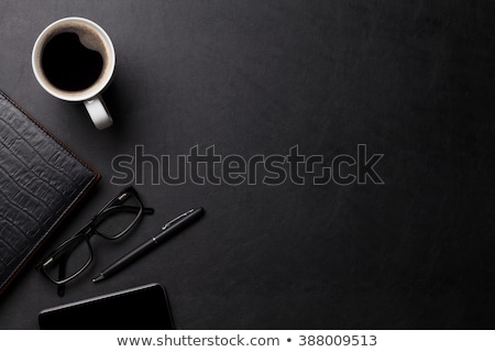 office leather desk with computer supplies and coffee stock photo © karandaev