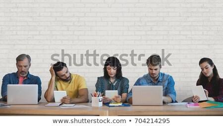Colegas digital tableta pared de ladrillo dos gente de negocios Foto stock © wavebreak_media