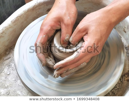Artisan hands making clay pot Stock photo © mady70