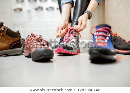 Woman buying sneakers shoes in shop Stock photo © Kzenon