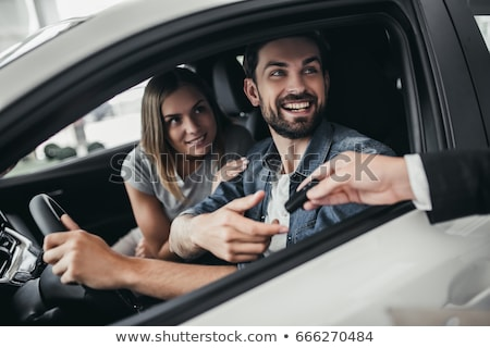 Woman choosing new car at dealership  Stock photo © Kzenon