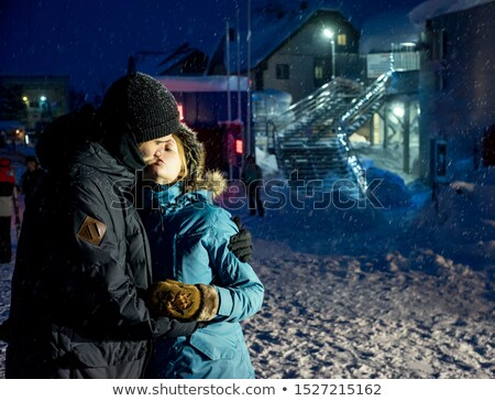 Smiling woman walking on stairs in winter mountain resort Stock photo © deandrobot