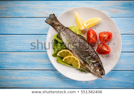 Grillowany pstrąg frytki naczyń żywności tablicy Zdjęcia stock © Digifoodstock