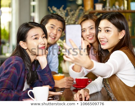 Four Asian people Stock photo © bluering