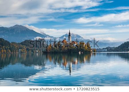 Meer Slovenië onderstelling kerk hemel natuur Stockfoto © CaptureLight