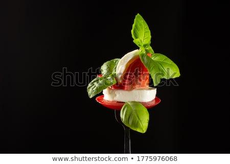 Mozzarella paradicsomok friss bazsalikom levelek vágódeszka Stock fotó © Digifoodstock