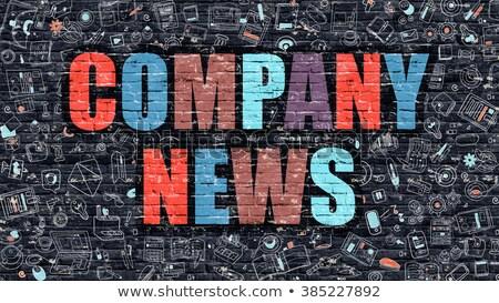 Company News on Dark Brick Wall. Stock photo © tashatuvango