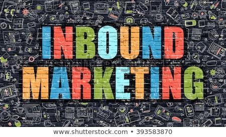 marketing concept multicolor on dark brickwall stock photo © tashatuvango