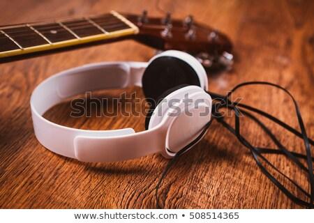 old headphones and guitar on wood stock photo © andreasberheide