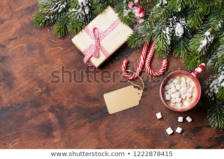 Christmas background with fir tree, gifts, hot chocolate Stock photo © karandaev