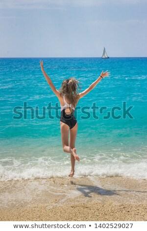Lány karok óceán természet gyermek szépség Stock fotó © IS2