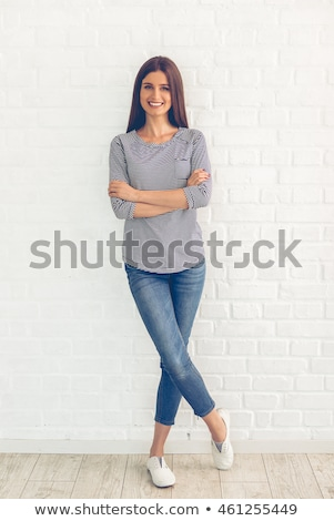 smiling young woman standing on one leg stock photo © filipw