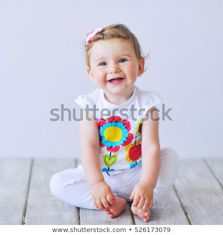 Stock photo: Face of a baby girl