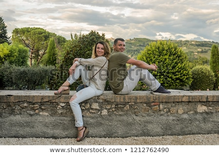 Seduta muro di pietra estate femminile maschio Foto d'archivio © IS2
