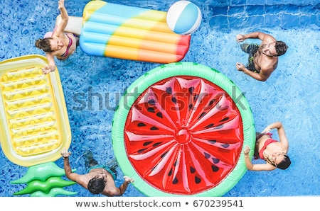 girl with beach ball by swimming pool stock photo © is2
