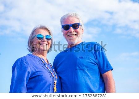 Mature couple wearing sunglasses Stock photo © IS2