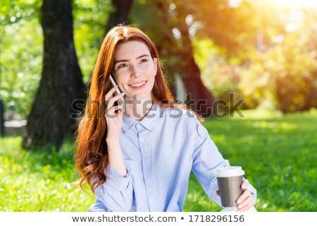 Beautiful redhead woman drinking coffe on sunny day Stock photo © konradbak