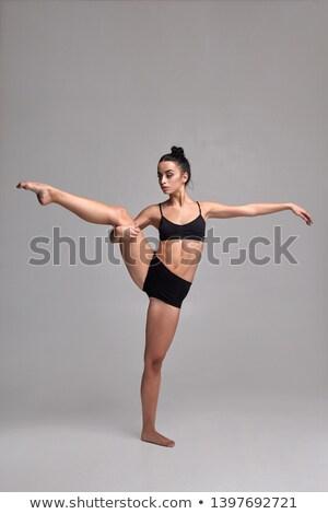 Retrato forte mulher jovem maiô posando em pé Foto stock © deandrobot