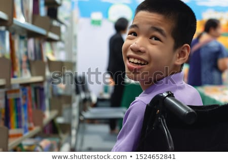 Stok fotoğraf: Young Student On Wheelchair In Disability Concept