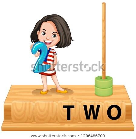 girl holding number two scene stock photo © bluering