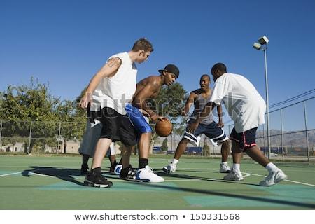 Groupe personnes jouer basket-ball jeunes Photo stock © boggy