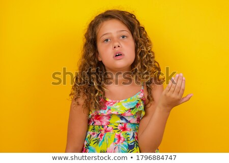 Frustrated black hair little girl by the wall Stock photo © boggy
