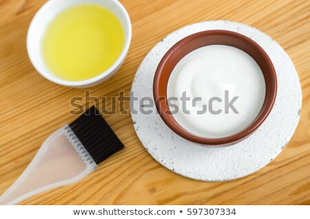 Stock photo: Homemade mask made of sour cream greek yogurt and olive oil. Diy cosmetics. Yogurt for spa treatment