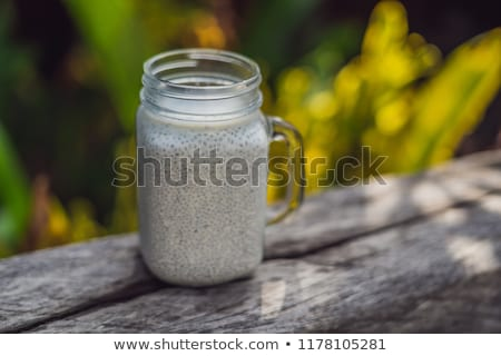 Healthy layered dessert with chia pudding in a mason jar on rustic background BANNER, long format stock photo © galitskaya